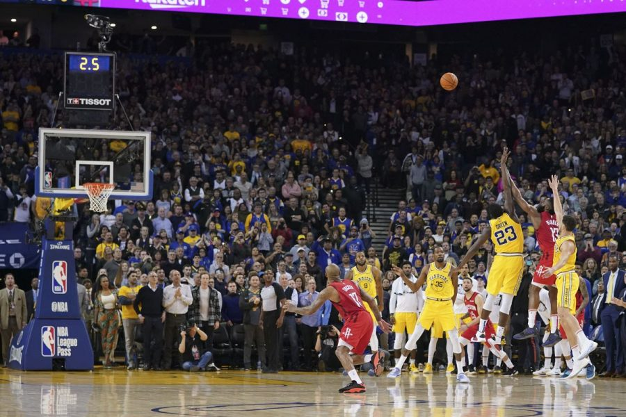 James Harden shoots a three-pointer to seal the game 135-134 for the Rockets, defeating the Golden State Warriors.