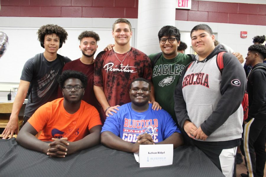Kasean Ridgel with his friends after the Bulls spring Signing Day.
