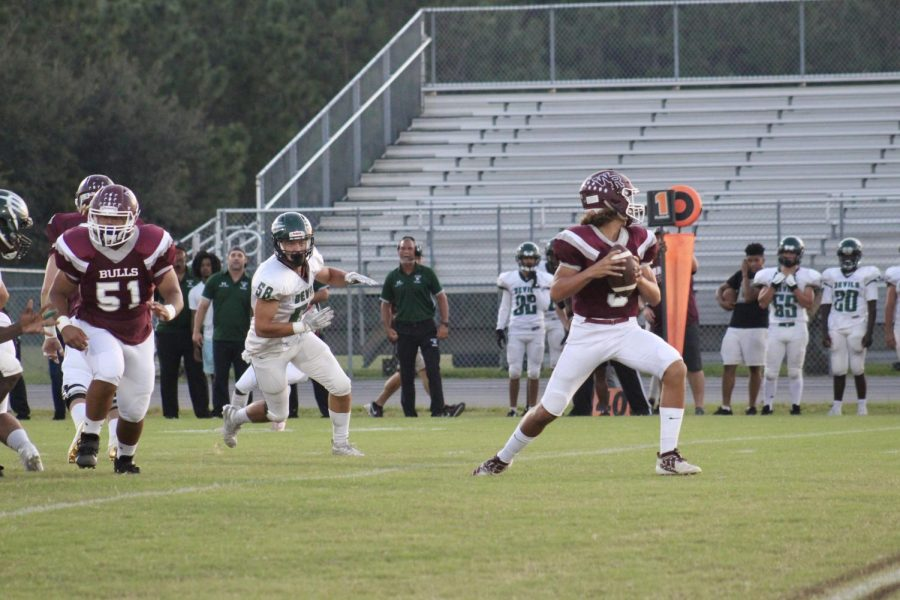 Quarterback Rocco Becht   avoiding the pressure from Saint Pete's defense during the Saint Pete game.