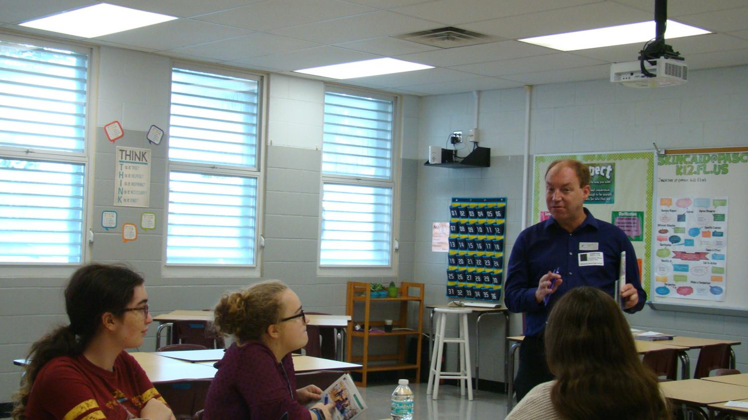 Christopher Moody, Florida Polytechnic University Office of Admissions, provides information to seniors about the university and how they provide students with a better education on campus and off campus