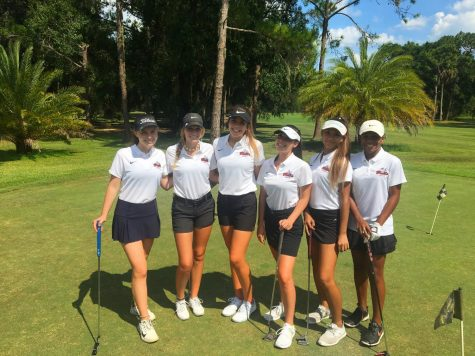 The top 6 players on the girls golf team pose for a photo before their match.