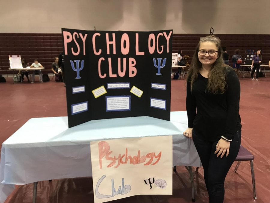 Makenzie Llyod is showing off the Psychology club for all students to see.