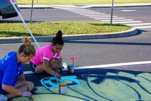 Taylor Krall and friend putting the final touches on her parking spot.