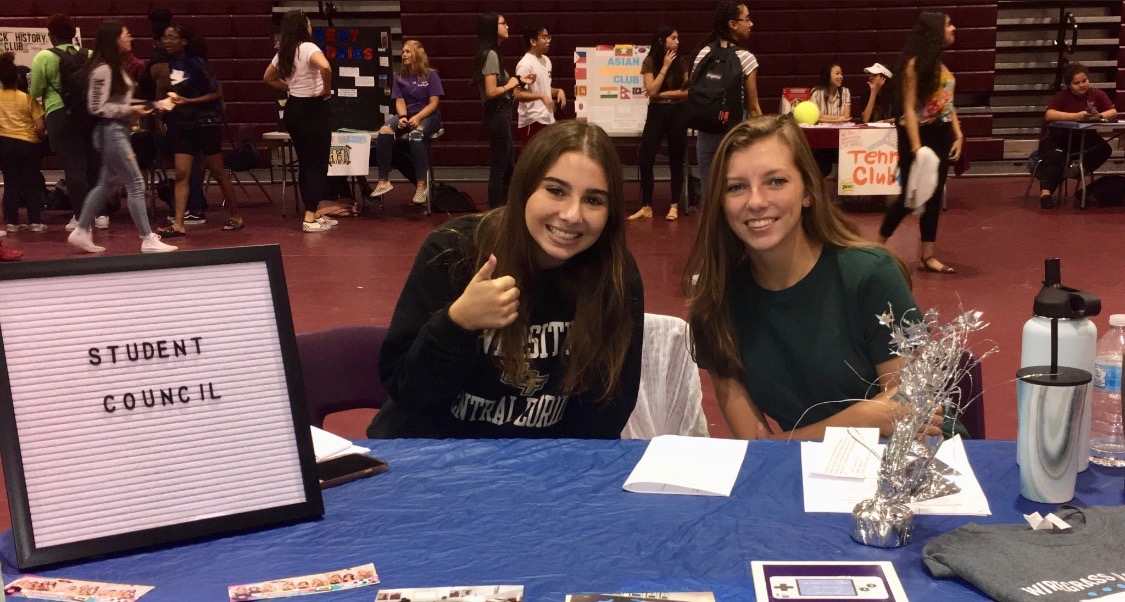 Student Council club recruiting new members at the club showcase.