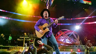 Garth Brooks playing during one of his songs on his