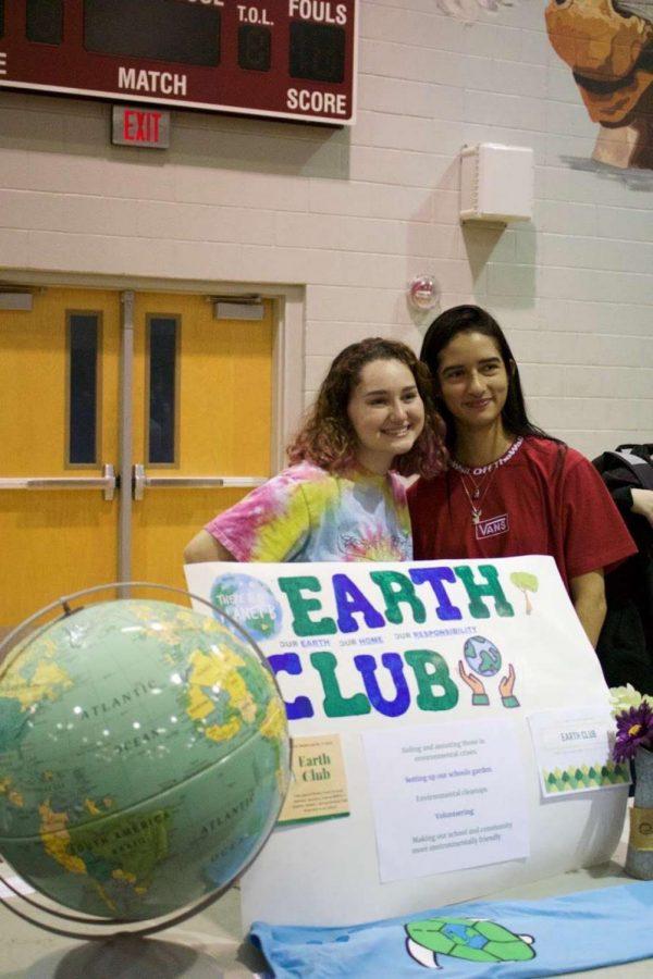 Earth club President Kara Weihman and club member at club presentation