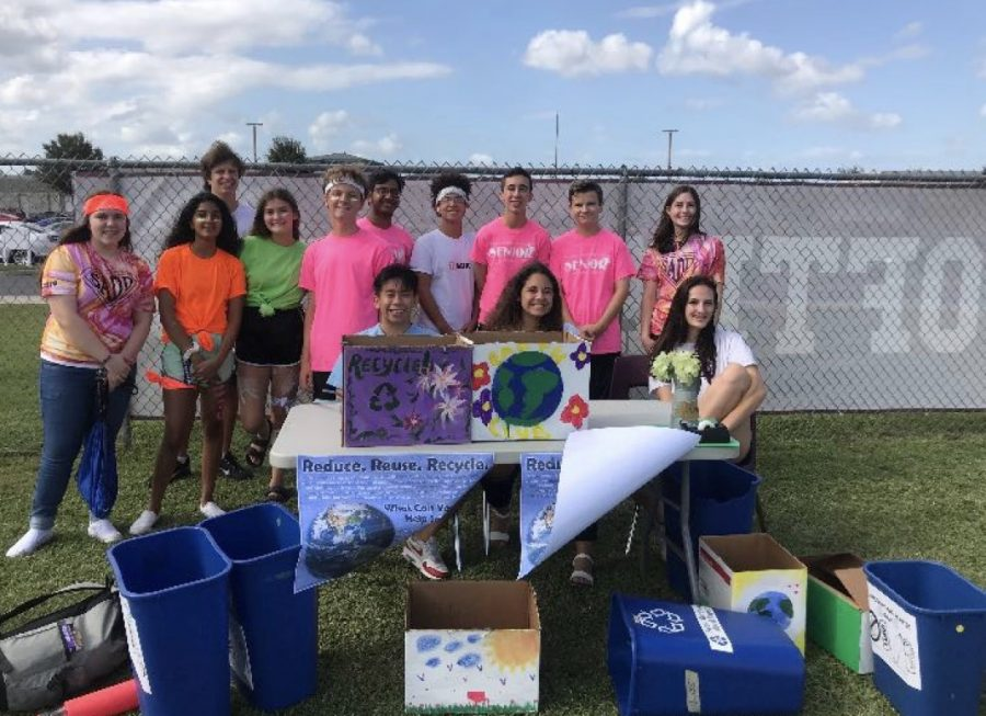 Earth club volunteering at the Fall Festival.