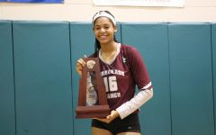Zoi Evans posing with the district championship trophy after beating Sunlake.