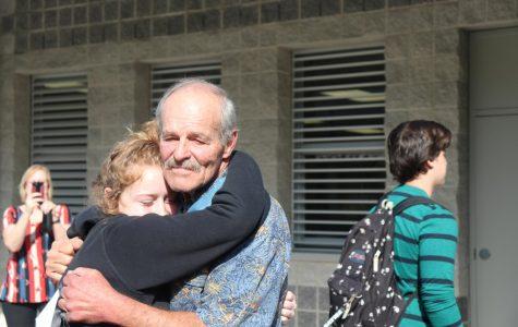 Emma Kerrick giving John Baca a hug after the presentation.
