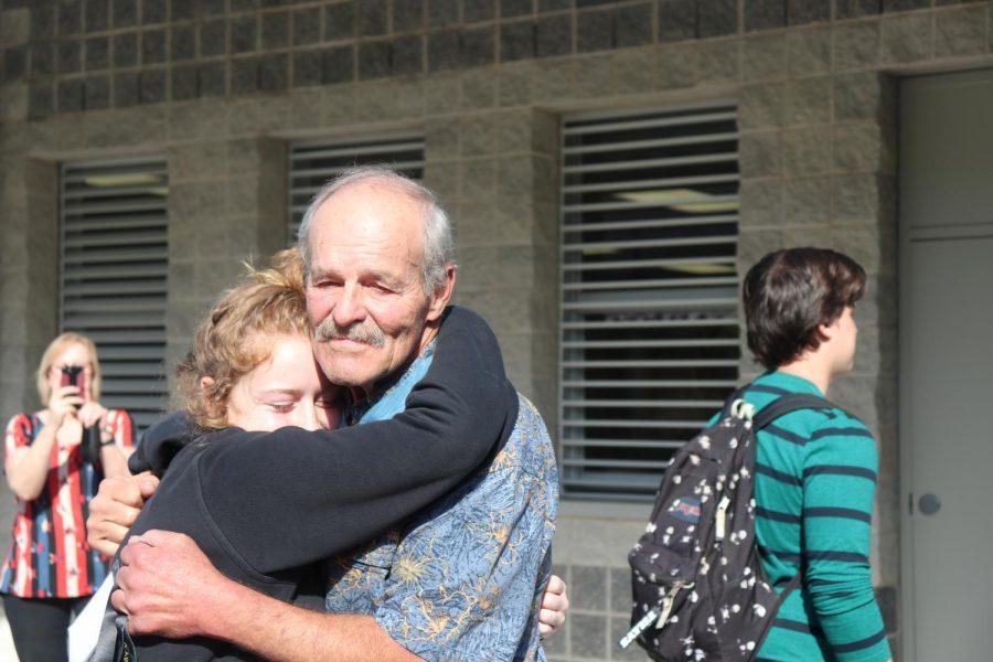 Emma+Kerrick+giving+John+Baca+a+hug+after+the+presentation.