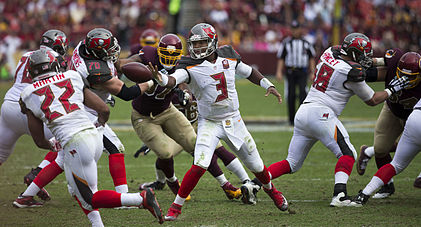 Jameis Winston pitches the ball in a game against the Redskins
