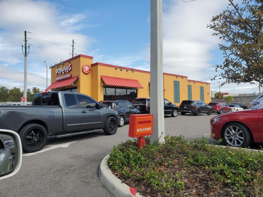 Wiregrass Ranch's local Popeyes's drive thru line for the sandwich.