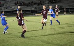 Senior forward Avery Damjanovic keeping possession of the ball away from Anclote.