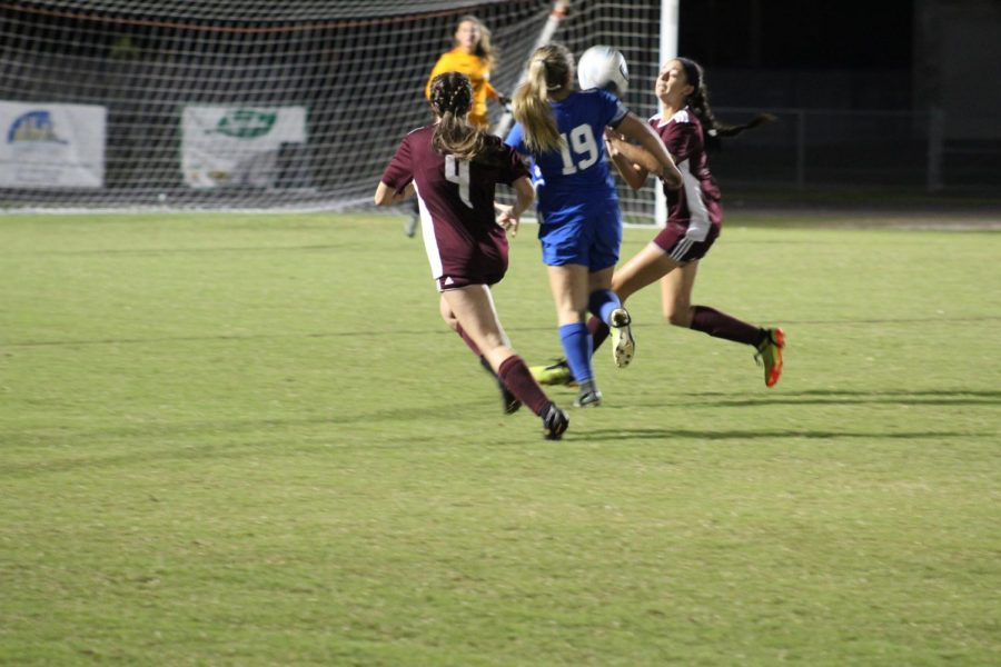 Sophomore defender Kayla Ojeda attempting to clear the ball away from Venice.