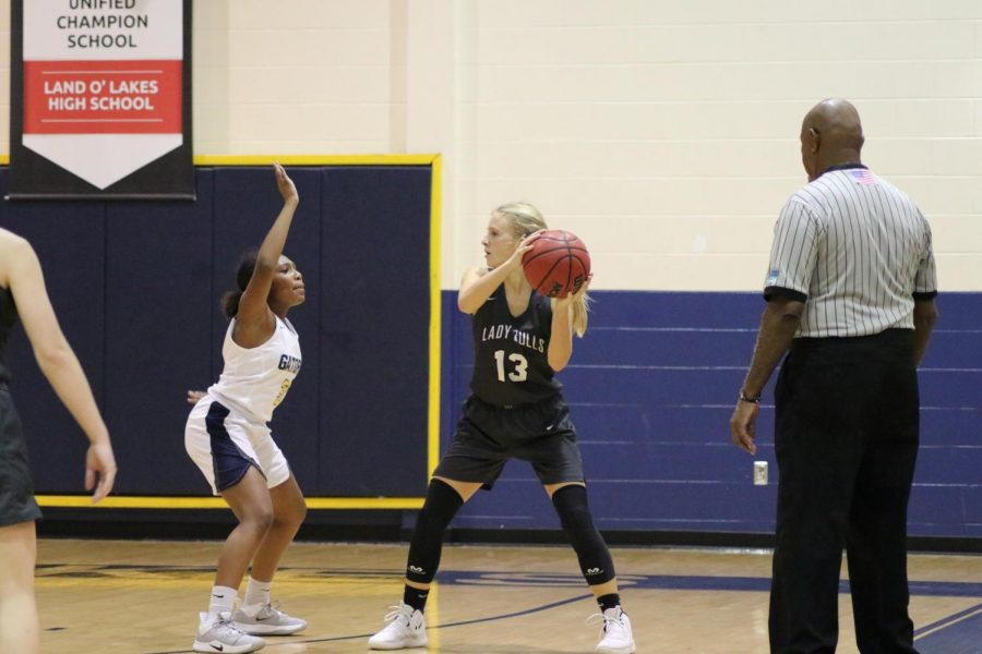 Senior Guard Allison Fleming looking for an open pass.