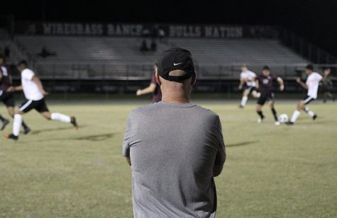 Coach Wilson watching the boys varsity game against Zephryhills High.