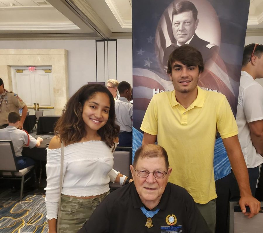 Mark Kieper and Emilie Ramos taking a picture with a medal of honor recipient at the convention.