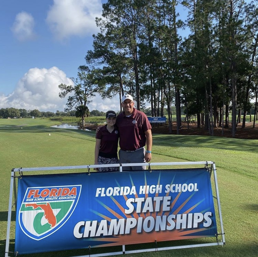 Calzone poses with number one golfer Norah Catlin at the 2019 High School Golf  Tournament.