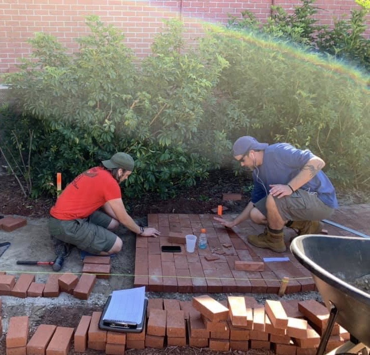 Hoehn working on his brick pathway
