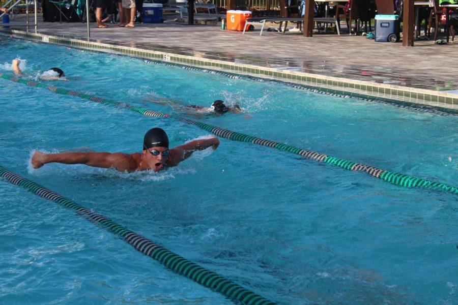Tilmann swimming fly at  a swim meet