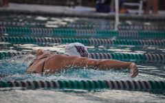 Salas swimming the breaststroke heat against River Ridge High School.