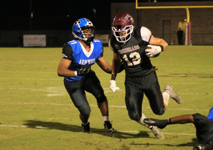 Senior Grady Clower, three-year varsity starter, beats two players from Armwood.