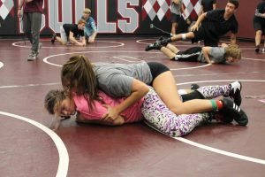 Wrestlers Madyson Harris and Jamie Sirianni practicing for the new season.