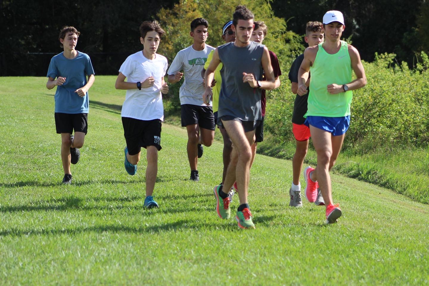 Boys cross country team running as they prepare for districts.