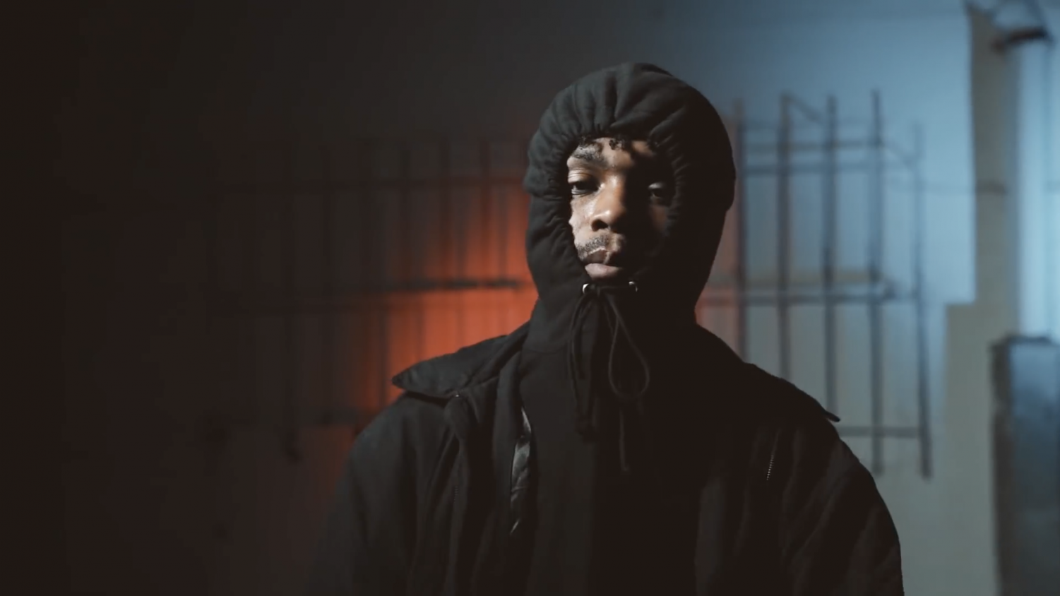 """Photo of rapper """"$NOT"""" with his signature hoodie that helps conceal his identity."""