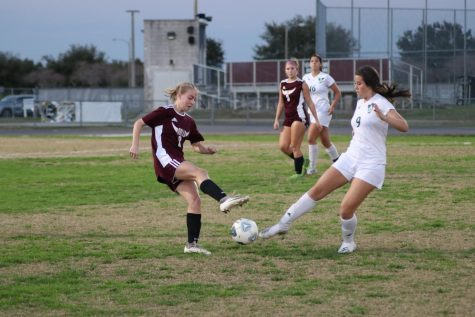 Rylee Humphries (5) attempts for ball possession.
