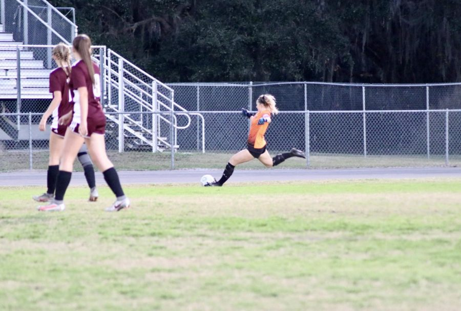 Ella McGahey and captain (0) getting the ball up on a goal kick.