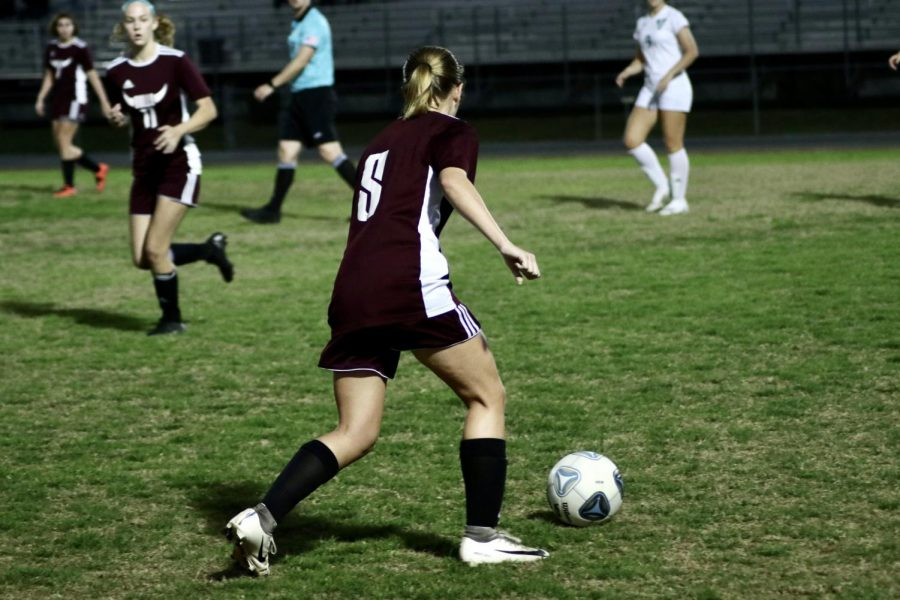 Rylee Humphries (5) passing ball to maintain possession.