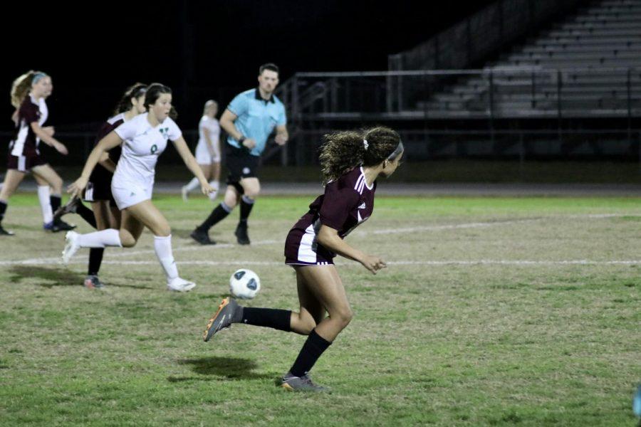 Lola Vargas (12) runs back to defend.