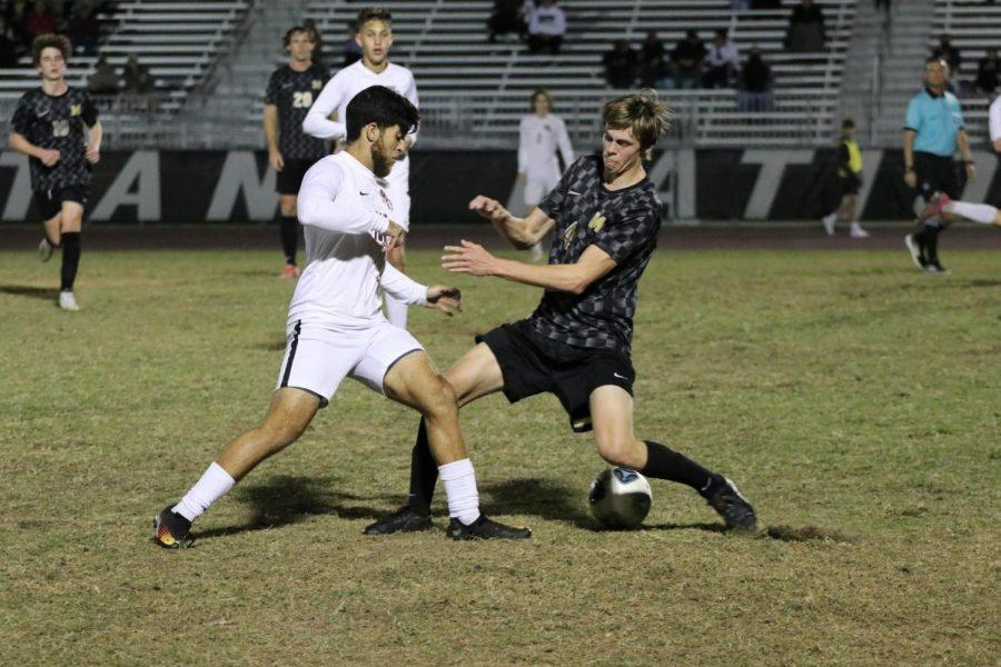 Osama Shehadeh (15), gets ball past defender.